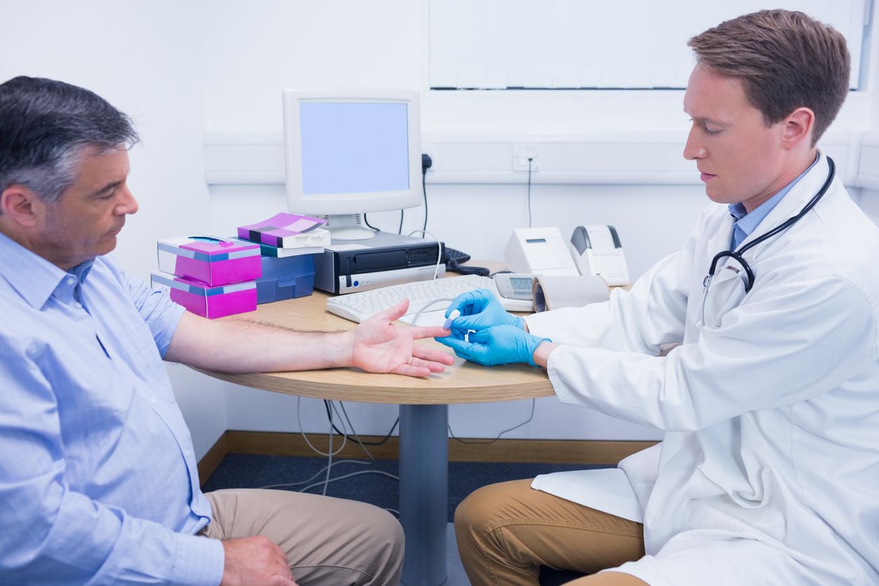 Doctor using a blood glucose meter
